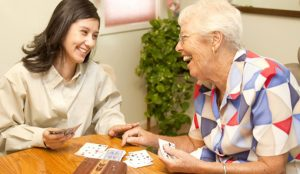 Granddaughter and Grandmother in nursing home laughing