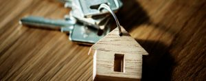 Keys with wooden house as a keyring