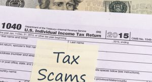 image of a sticky note that says Tax Scams